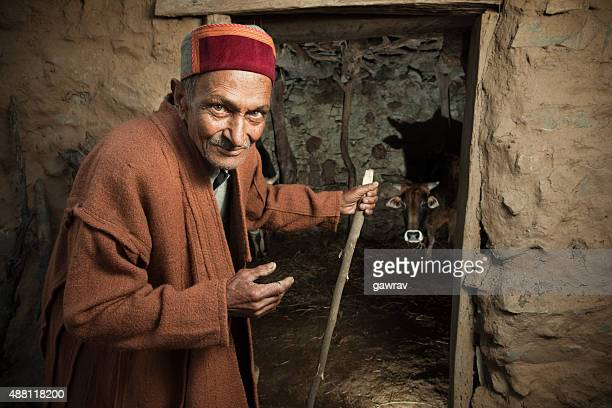 Senior rural man of Himachal Pradesh near barn.