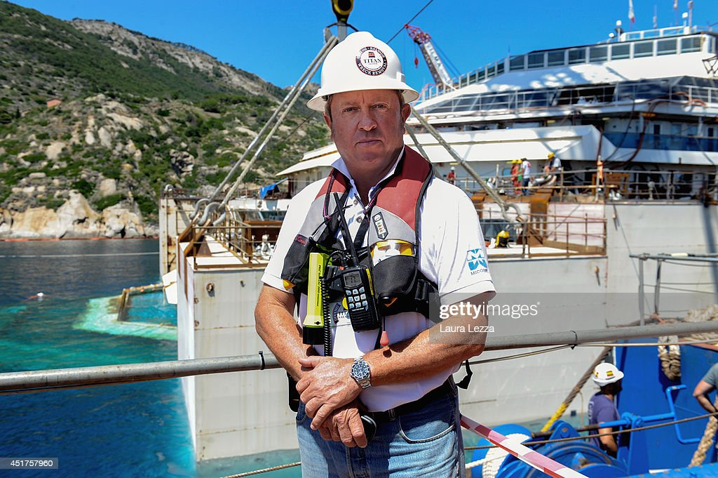Senior Salvage Master Nick Sloane poses for a photo while the last sponson is installed on the port side of the wrecked ship Costa Concordia on July 3, 2014 in Isola del Giglio, Italy. A total of 30 sponsons have been attached to the Costa Concordia to re-floate the ship wreck around July 10th. The wreckage will be removed by the end of July 2014 and will be toed to the port of Genoa for dismantling.