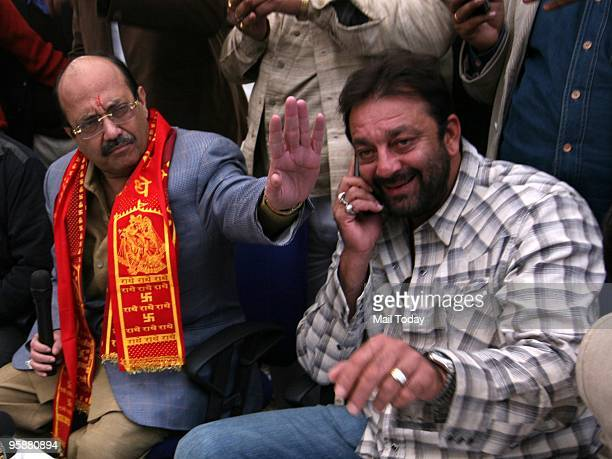 Senior Samajwadi Party Leader Amar Singh gestures as he addresses a press conference as Indian Actor Sanjay Dutt looks on during a press conference...