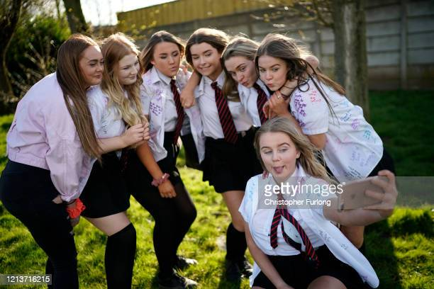 Senior schoolchildren mark their 'leavers' day early with a selfie as they head home and schools are closed due to the ongoing coronavirus pandemic...