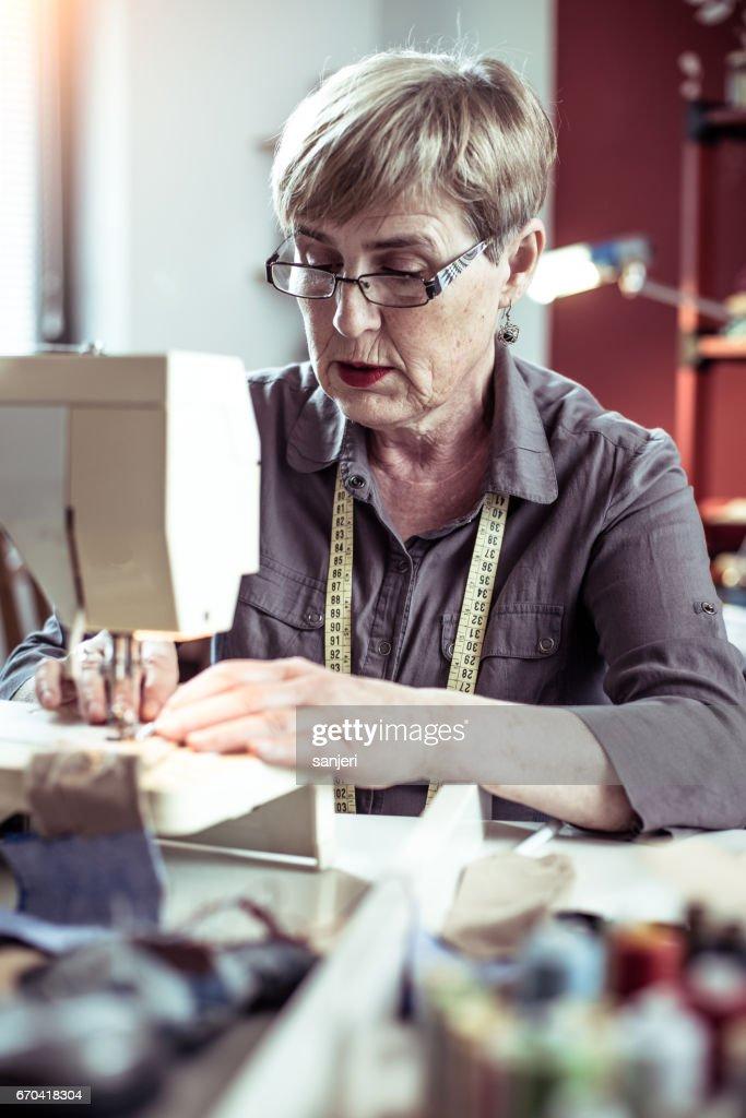 Senior Seamstress Sewing : Stock Photo