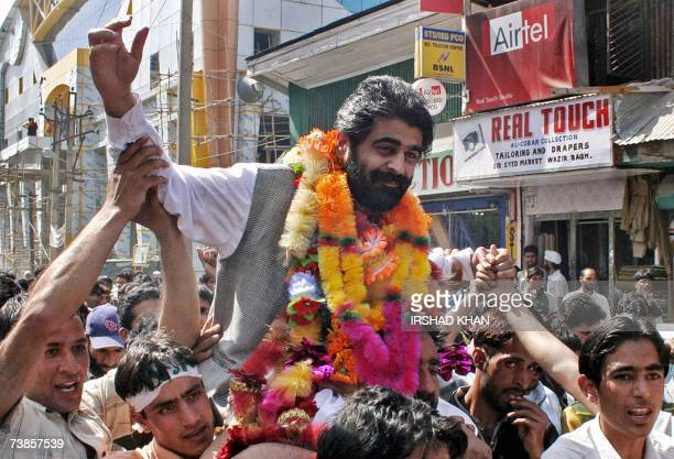 Senior separatist leader and chairman of the Jammu and Kashmir National Front Nayeem Khan is is carried on the shoulders of party supporters shouting...