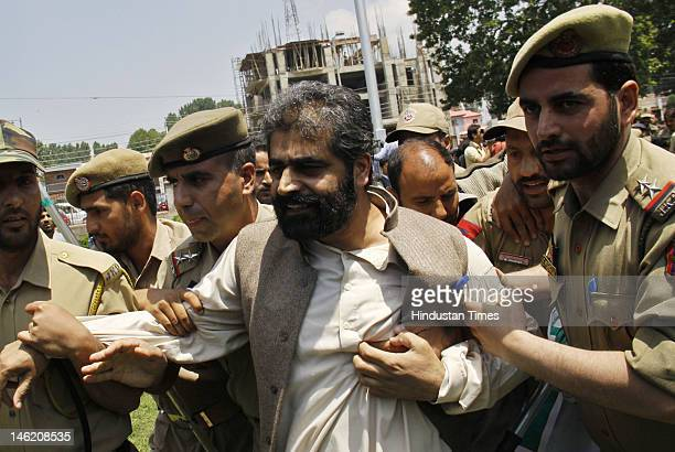 Senior separatist leader Nayeem Khan detained by police during a protest on June 12 2012 in Srinagar India Several separatist leaders were leading...