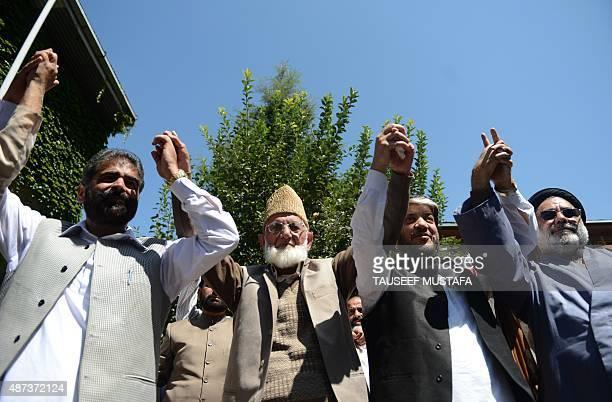 Senior seperatist leader Nayeem Khan Kashmiri separatist leader Syed Ali Shah Geelani Shabir Shah and Shia cleric Aga Syed Hassan join hands during a...