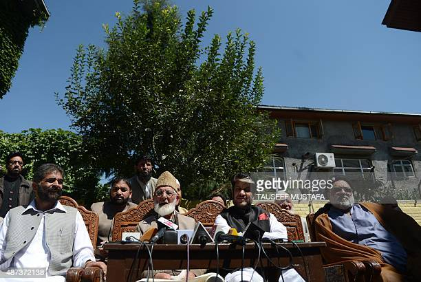 Senior seperatist leader Nayeem Khan Kashmiri separatist leader Syed Ali Shah Geelani Shabir Shah and Shia cleric Aga Syed Hassan speak during a...