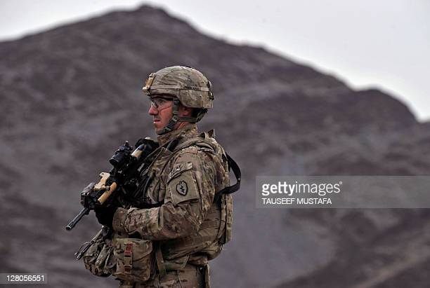 Senior Sergeant Martin Evin from the US army Alfa battery company HHB 3-7 Field Artillery Regiment 3rd Bct 25th ID looks on during a mission in the...