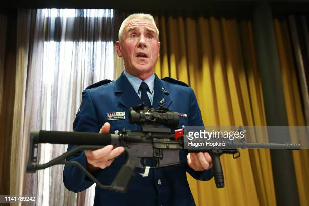 Senior sergeant Paddy Hannon shows a gun to media during a media conference at the Royal Society on April 11 2019 in Wellington New Zealand New...