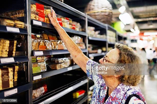 Senior shopping in supermarket