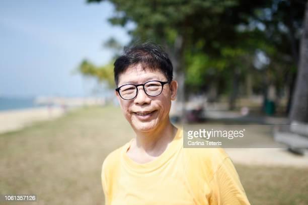 senior singaporean man in a park - シンガポール文化 ストックフォトと画像