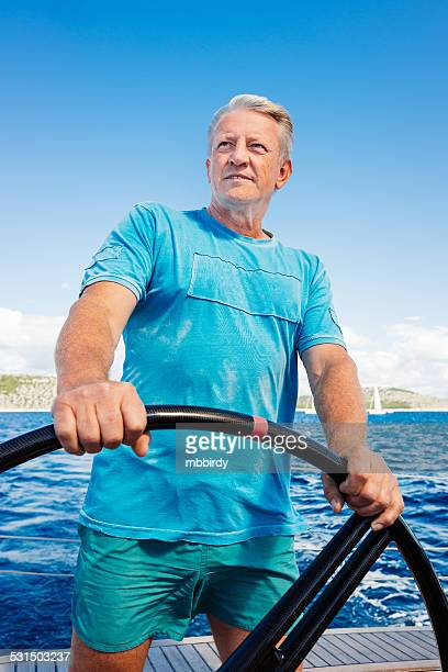 Senior skipper sailing with sailboat