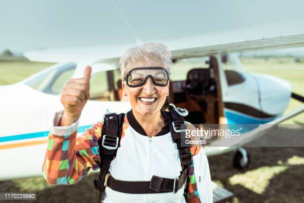 senior skydiver - extreme sports stock pictures, royalty-free photos & images