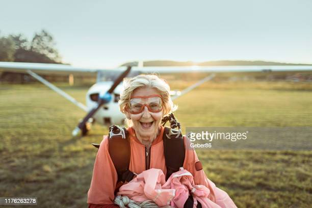 senior skydiver - hormone stock pictures, royalty-free photos & images