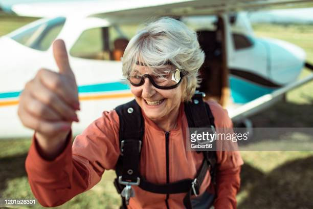 senior skydiver - active lifestyle stock pictures, royalty-free photos & images