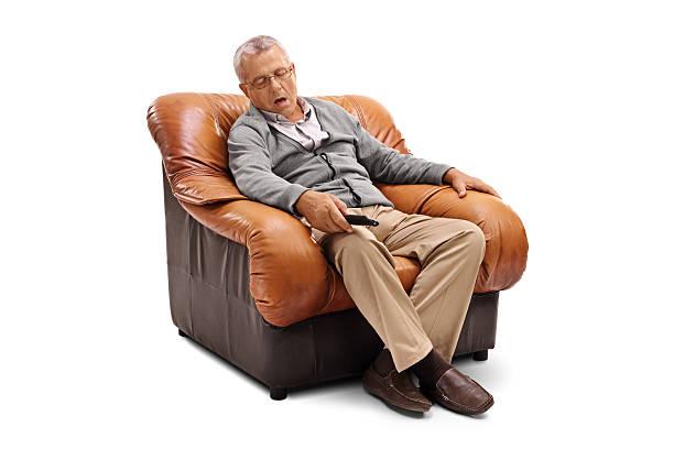 Senior sleeping on an armchair