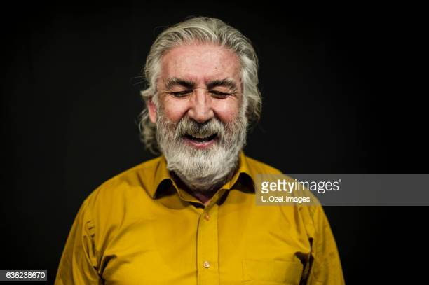 Senior Smiling Man Portrait Front of A Black Wall