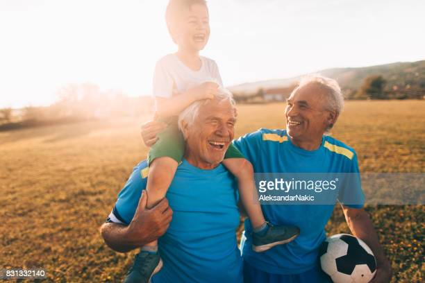Senior soccer players and their grandson
