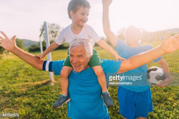 senior soccer players and their grandson - serbia stock pictures, royalty-free photos & images