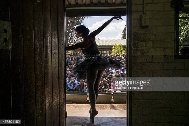 Senior soloist of the Joburg Ballet Kitty Phetla performs in a classroom at the NkaThuto Primary School in Soweto on October 16 2014 Using ballet and...