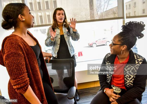 Senior Soorer Bulhan left sophomore Abe Merker center and senior Drey Awosika right talk after GW professors hold a teach in to have a conversation...