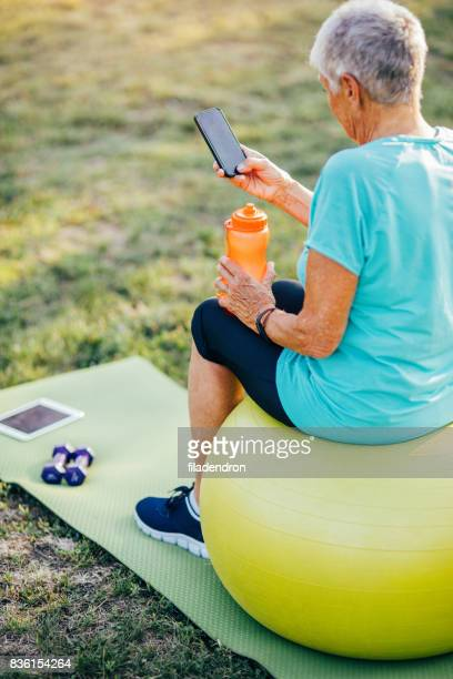 Senior sportswoman using a smart phone