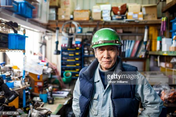 a senior steel worker in the shipbuilding industry - working seniors stock pictures, royalty-free photos & images