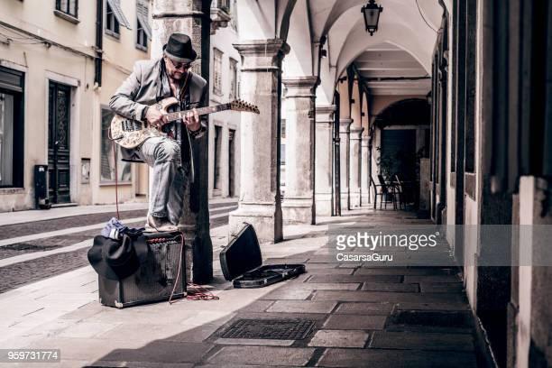 Senior Street Artist Enjoying Playing Electric Guitar in the Street