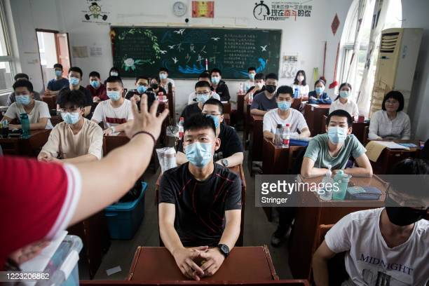 Senior students attend a class in a high school in Wuhan on May 6 2020 in Wuhan Hubei Province ChinaSenior students in 121 high and vocational...