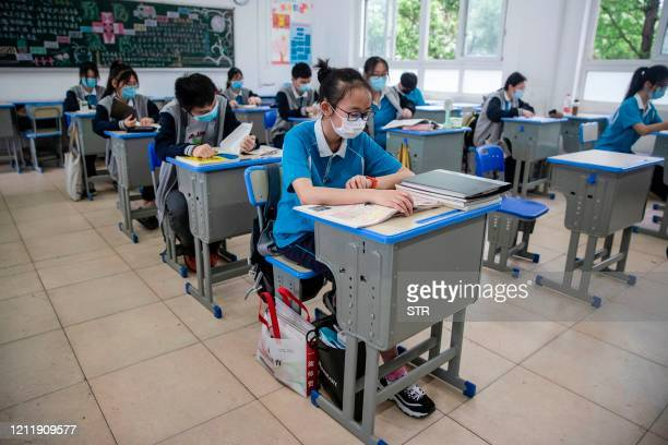 TOPSHOT Senior students attend class at a high school in Wuhan in China's central Hubei province on May 6 2020 Senior school students returned to...