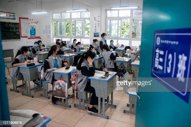 Senior students attend class at a high school in Wuhan in China's central Hubei province on May 6, 2020. - Senior school students returned to class...