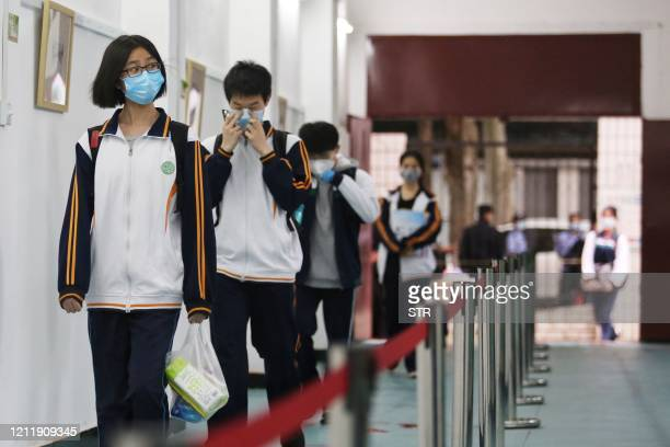 Senior students enter a high school in Wuhan in China's central Hubei province on May 6 2020 Senior school students returned to class on May 6 in the...