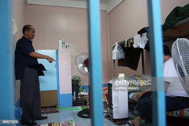 Senior Superintendent Pedro Austria regional chief of the Philippine National Police Criminal Investigation and Detection Group inspects the cell of...