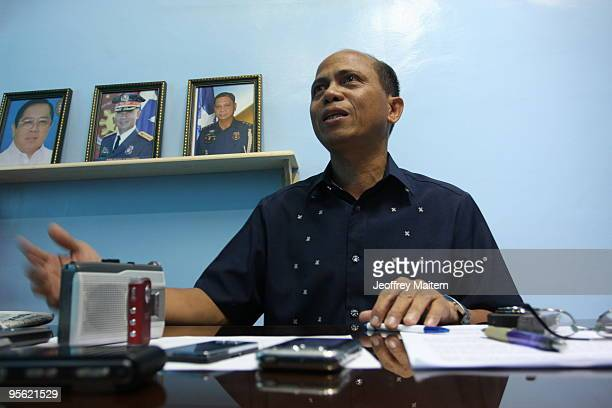 Senior Superintendent Pedro Austria regional chief of the Philippine National Police Criminal Investigation and Detection Group answers reporter's...