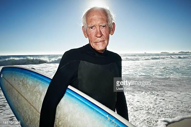 Senior surfer on beach, portrait