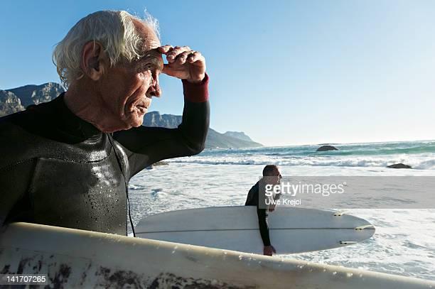 Senior surfers on beach