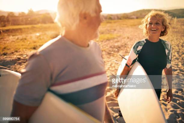 senior surfers - active lifestyle stock pictures, royalty-free photos & images