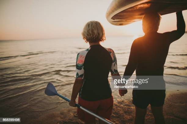 senior surfers - baby boomer stock pictures, royalty-free photos & images