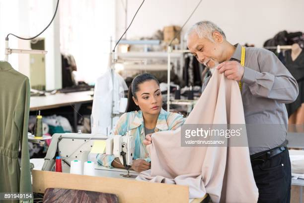 Senior tailor observing in textile factory