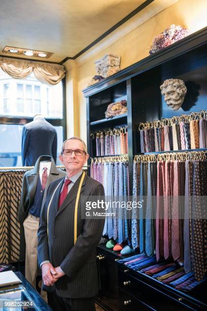 senior tailor wearing shirt and tie in tailors shop, portrait - custom tailored suit stock pictures, royalty-free photos & images