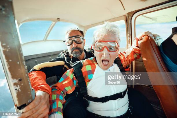 senior tandem skydiving - fear stock pictures, royalty-free photos & images