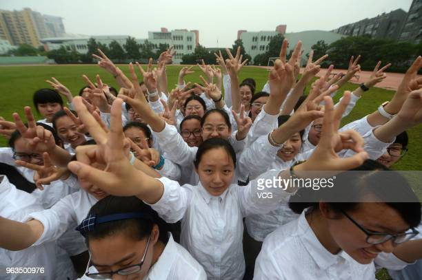 Senior three students of Hanjiang High School of Jiangsu Province pose as Chinese characters '2018 Gaokao Come On' during 'stress relief' event ahead...