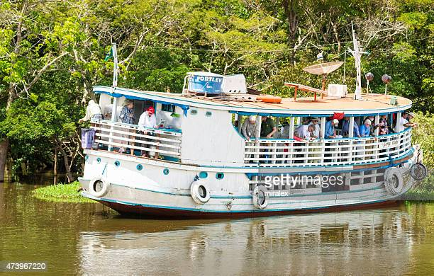 senior tourists are fishing for piranha on amazon river, brazil - passenger craft stock pictures, royalty-free photos & images