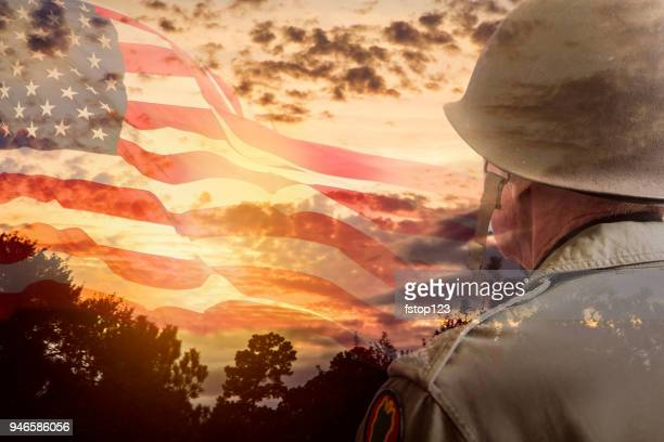 senior usa army soldier overlay sunset, american flag. - armistice day stock photos and pictures