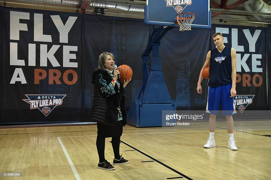 Senior Vice President at Delta Air Lines, Gail A. Grimmett (L) and NBA basketball player for the New York Knicks, Kristaps Porzingis celebrate Delta Air Lines Fly Like a Pro campaign with a H-O-R-S-E competition at Chelsea Piers in New York City on March 2, 2016.
