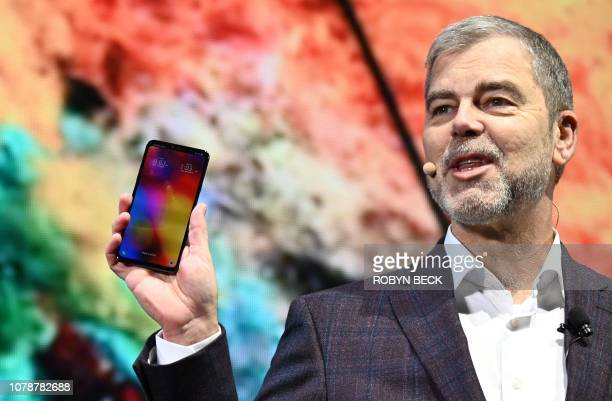 Senior Vice President David VanderWaal holds the LG V40 phone at the LG press conference at the Mandalay Bay Convention Center during CES 2019 in Las...
