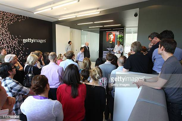 Senior Vice President Editorial Imagery Adrian Murrell addresses staff at the Getty Images London office prior to a minutes silence held in...