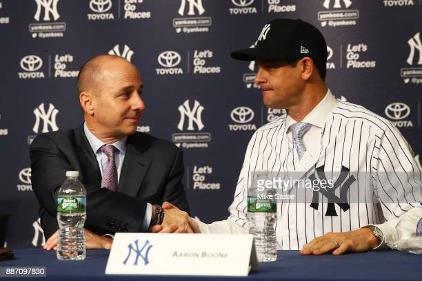 Senior Vice President General Manager Brian Cashman shakes New York Yankee manager Aaron Boone hand at Yankee Stadium on December 6 2017 in the Bronx...
