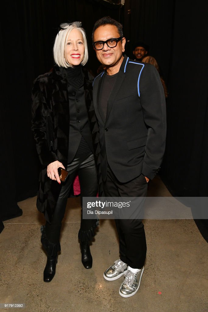 Senior vice president of Bergdorf Goodman Linda Fargo and designer Naeem Khan pose backstage for Naeem Khan during New York Fashion Week: The Shows at Gallery I at Spring Studios on February 13, 2018 in New York City.