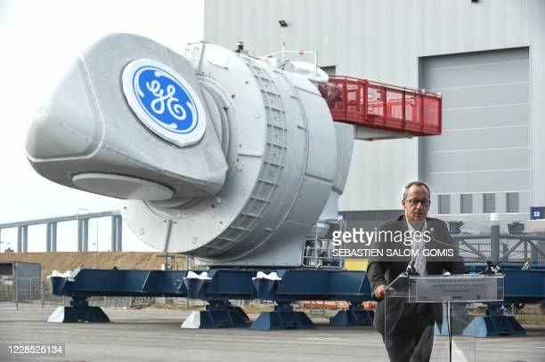 Senior vice president of General Electric and CEO of General Electric Renewable Energy Jerome Pecresse delivers a speech in front of the first of the...