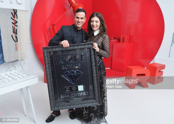 Senior Vice President of Media at Universal Music Group Jim Roppo at Universal Music Group Joseph Carozza and singer Lorde pose with a plaque...
