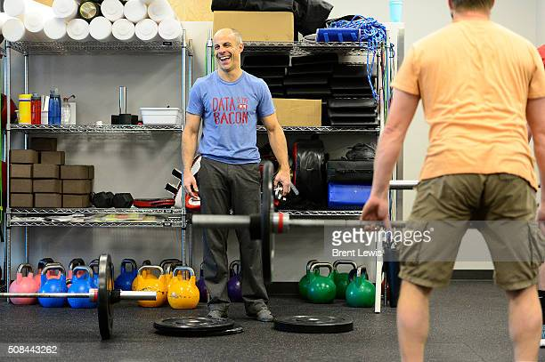 Senior Vice President of Oracle Data Cloud Eric Roza jokes with employees during their session of crossfit in the gym at Oracle Data Cloud on...